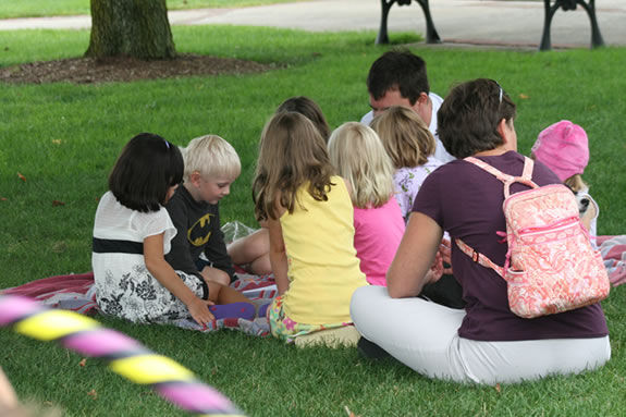 The Beverly Farmers' Market now has story time under the tree for kids