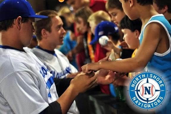 Players from the North Shore Navigatgors sign balls for fans!