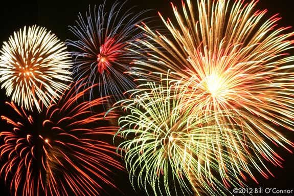 Manchester's Fireworks display is launched from a barge moored off Singing Beach. Photo ©2012 Bill O'Connor