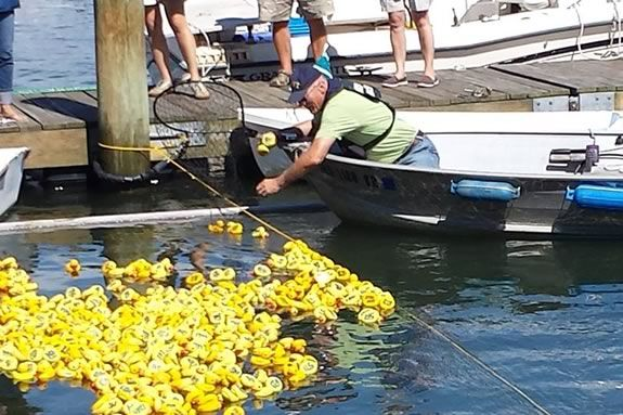 "The Danvers Kiwanis Annual ""Rubber Duck Race"" raises money for scholarship funds for local college students"