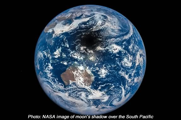 Photo: NASA image of moon's shadow over the South Pacific