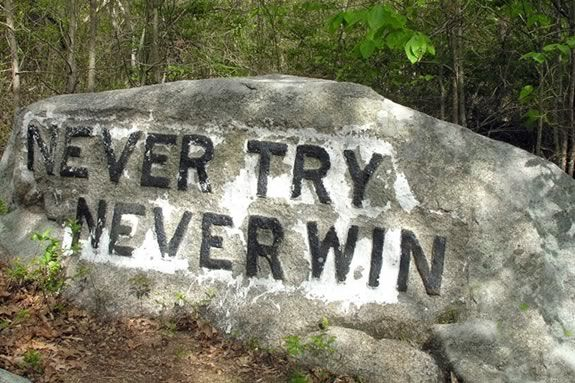 Never Try Never Win is just one of the boulders commision for carving by Roger Babson