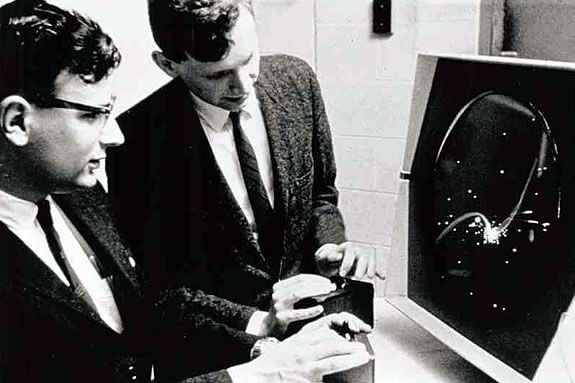 Dan Edwards and Pete Samson play Spacewar! at MIT in 1962.