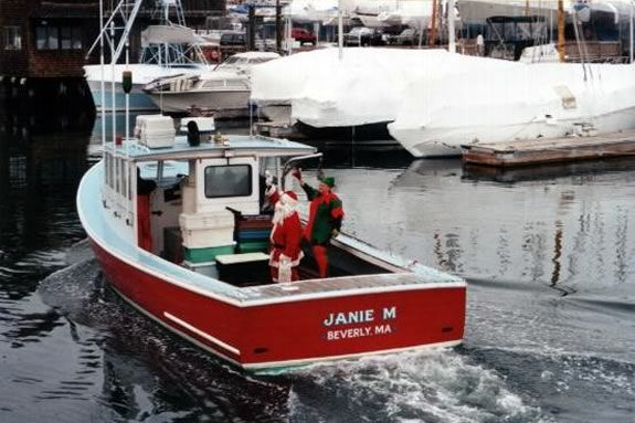 Santa arrives in Beverly Harbor by lobster boat.